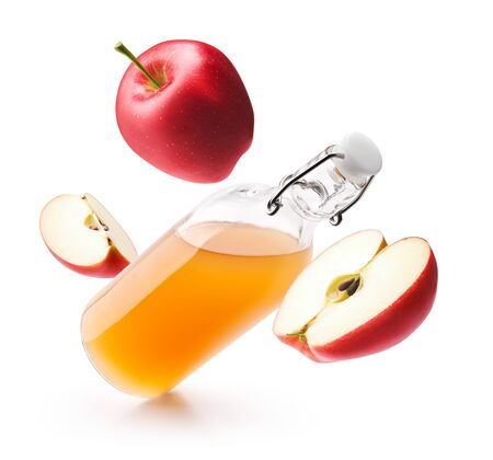 Apple cider vinegar with fresh red apples isolated on white background Stock Photo