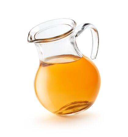 Apple juice in a pitcher isolated on white