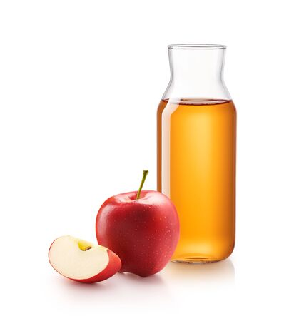 Bottle of apple juice with red apples isolated on white