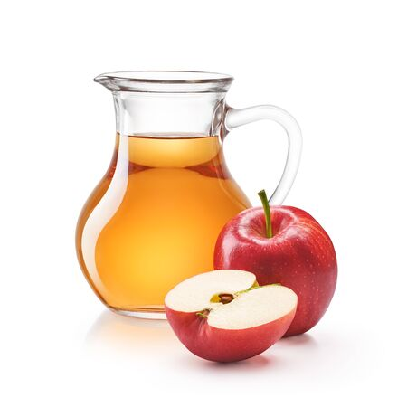A jug of apple juice with red apples isolated on white
