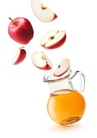 Apple juice and red apples isolated on white