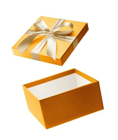 Gold color open gift box isolated on white background