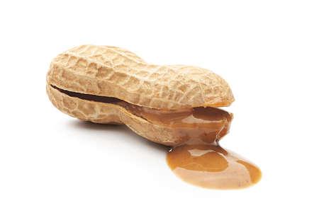 Peanut butter paste leaking from opened peanut Zdjęcie Seryjne
