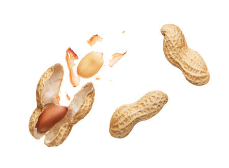 Opened shell peanut and unpeeled peanuts over white background