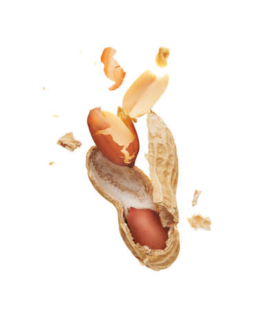 Peanut crushed into pieces over white background