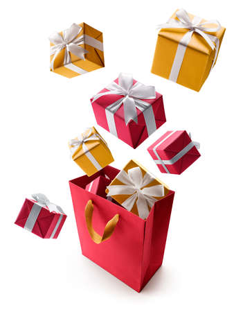Red and gold gift boxes pop out from shopping bag over white background