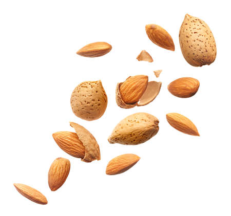 Group of almonds splashing over white background