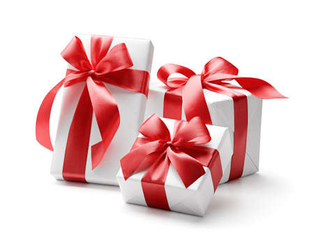 White gift boxes with red bows isolated on white
