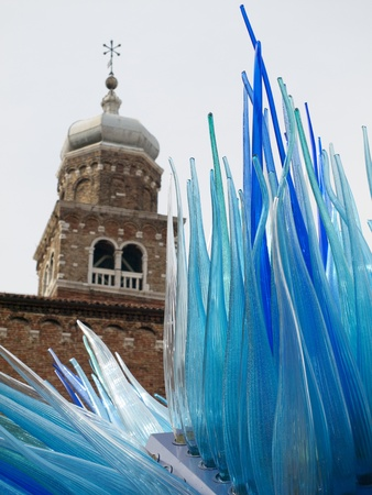 enormous: Enormous blue glass sculpture in front of tower on the Venetian island Murano, Italy