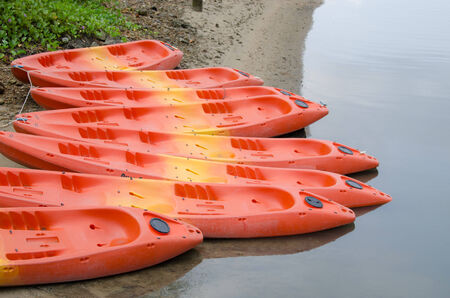 Colorful fiberglass kayaks tethered to each other Stock Photo