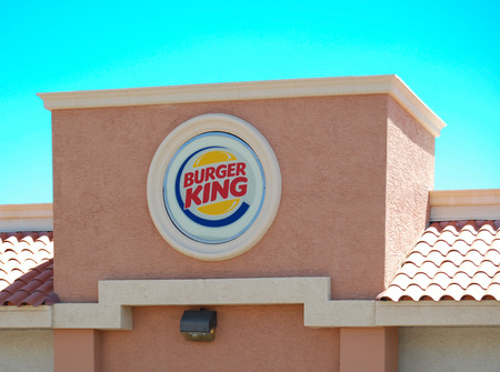unincorporated: Mesa, AZ, USA - August 6, 2014   Burger King was founded in 1953 and is headquarted in unincorporated Miami-Dade County, Florida  At the end of fiscal year 2013 Burger King had 13000 stores in 79 countries  August 6,2014