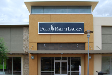 eventually: Mesa, AZ, USA - August 18, 2014: The Ralph Lauren Corporation was established in 1967 in Bronx, NY, eventually extending to international markets. The store sells men