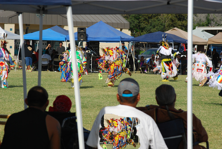 pow wow: Mesa, AZ, USA - October 26, 2014: Spectators watching the 31st annual Roy Track Memorial Pow Wow. A gathering of tribes from all over the US performing dancing and singing on October 26, 2014.