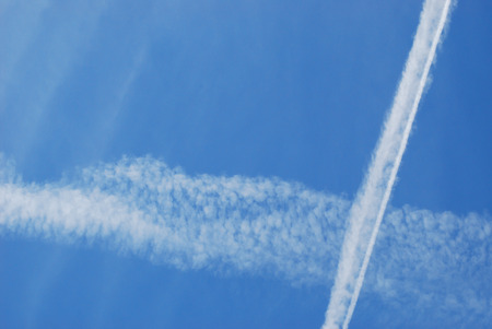 Contrails crossing each other at a high altitude above Phoenix, arizona Reklamní fotografie