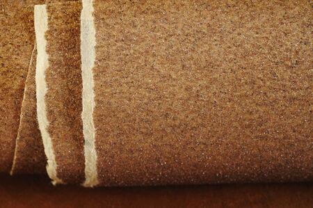 sandpaper: Sandpaper on wooden background