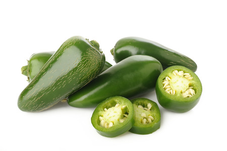 green jalapeno peppers on white background