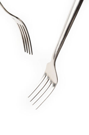 Metal fork  on white background