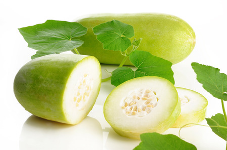 Slices of wax gourd on white background photo