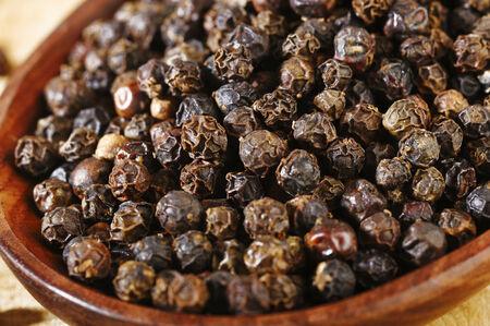 black pepper: black pepper in wooden spoon Stock Photo