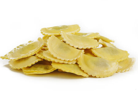 ricotta cheese: agnolotti pasta stuffed with spinach and ricotta cheese on white background