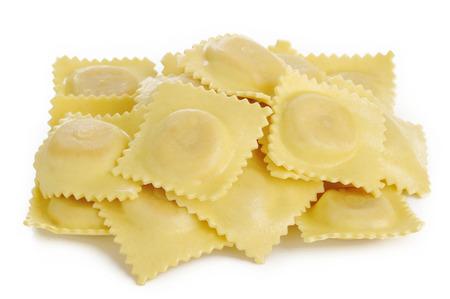 Dry ravioli pasta on white background