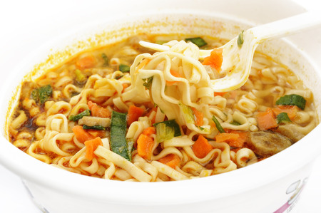 cooked instant noodle: instant noodles in cup Stock Photo