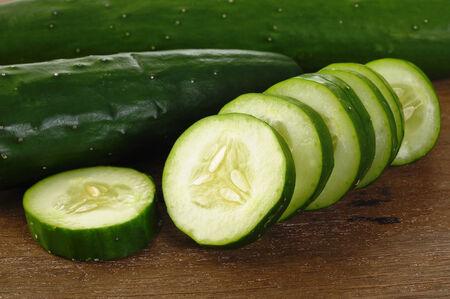 fresh cucumbers on wooden background Фото со стока