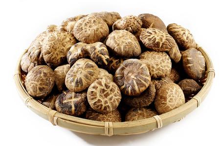 dried shiitake mushrooms in basket Фото со стока