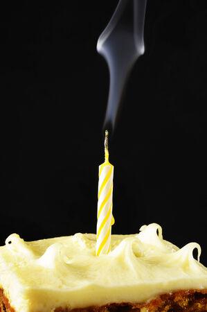candle with smoke on black background photo