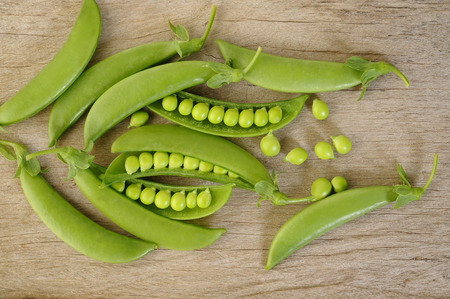 snap: fresh sugar snap peas on wooden background