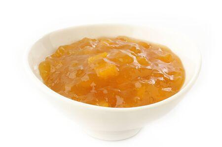peach jam in white bowl