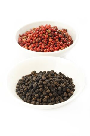 flavorings: red peppercorns seeds and black pepper Stock Photo