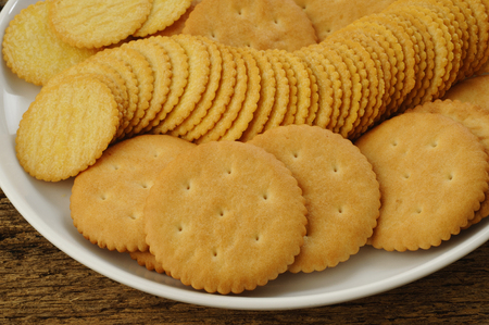 salty: salty crackers on plate Stock Photo