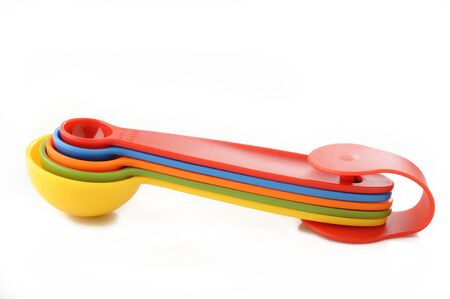 measuring spoon: colorful plastic measuring spoon on white background
