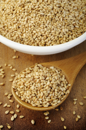 roasted sesame: roasted sesame seeds in wooden spoon