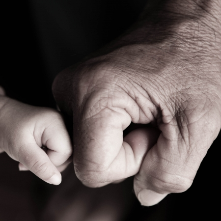 fist bump of smallhand and bighand Standard-Bild