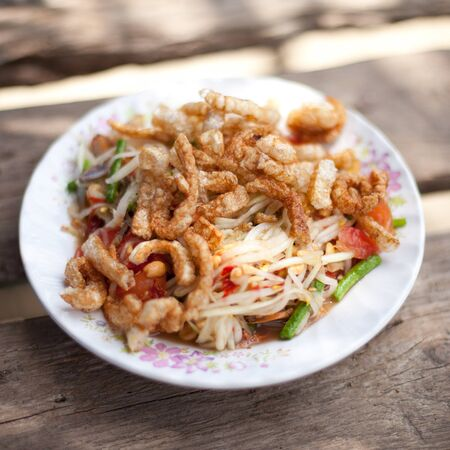 Somtam with Fried skin pork photo