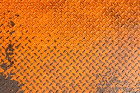 Rusty orange metal ground Standard-Bild