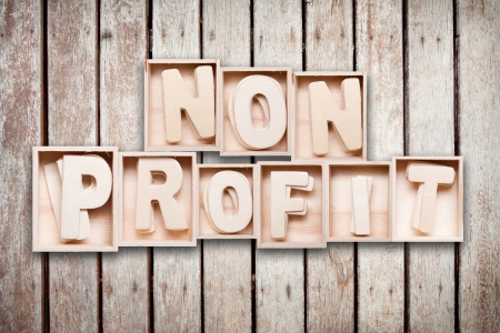 Non profit wood word style Standard-Bild