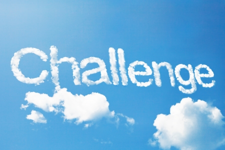danger ahead: challenge a cloud word on sky Stock Photo