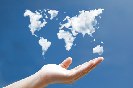 business environment: world map cloudshape floting on hand