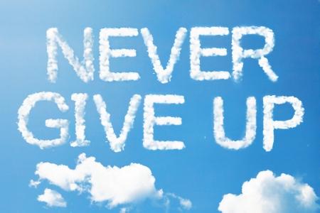 Never give up a cloud  massage on sky Standard-Bild