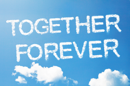 couple embrace: Together forever a cloud  massage on sky Stock Photo