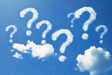 questions: Question mark shaped clouds on blue sky Stock Photo