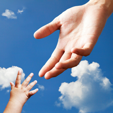 baby hand: Connecting between adult hand and baby hand on sky
