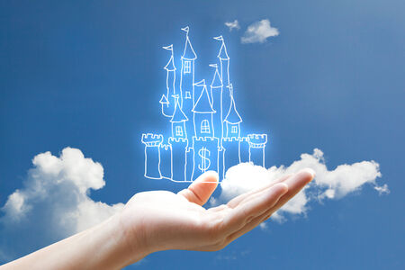 lowbrow:   Vivid line money castle on hand n the sky