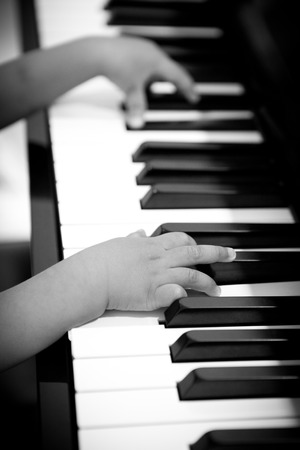 Little hands playing on the piano photo