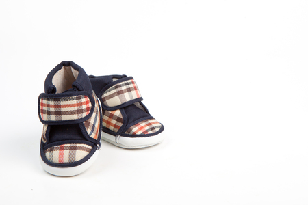 baby shoe: scotch pattern baby shoe in traditional style isolation