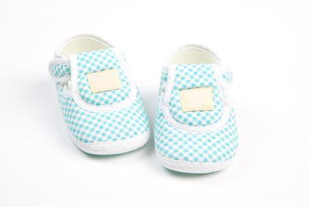 baby shoe: blue scotch pattern baby shoe in traditional style isolation