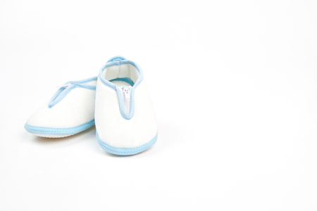 baby shoe: blue and white baby shoe in traditional style isolation Stock Photo